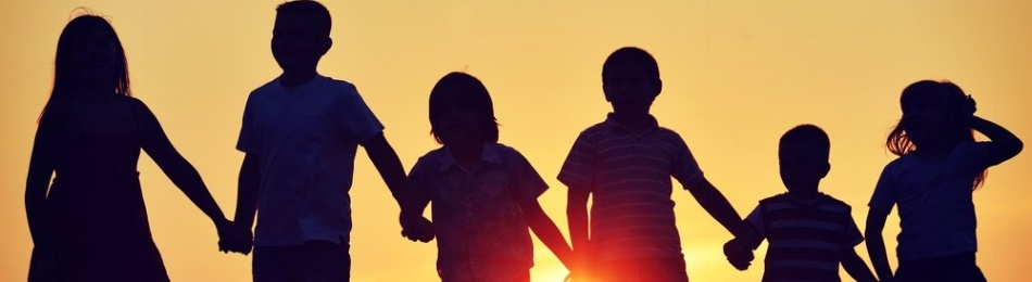 Image: children silhouetted by the setting sun, working on one of these fun local fundraising ideas